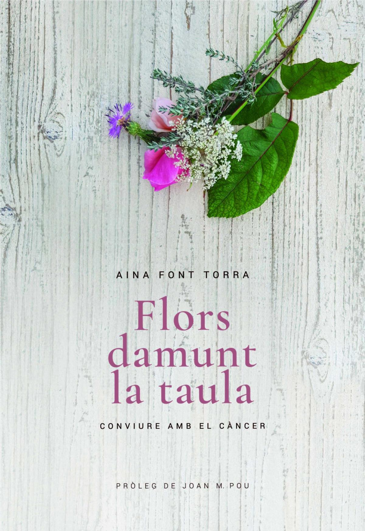 FLORS DAMUNT LA TAULA